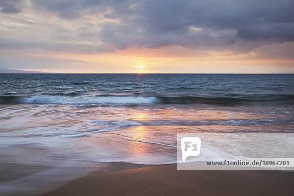 'Soft ocean waves at sunset from Kamaole Beach; Maui  Hawaii  United States of Amerida'