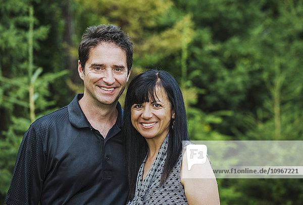 'Portrait of a mature couple outdoors in autumn; Sherwood Park  Alberta  Canada'