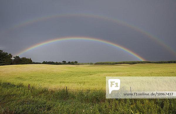 'Double rainbow over farm field; Caledon  Ontario  Canada'