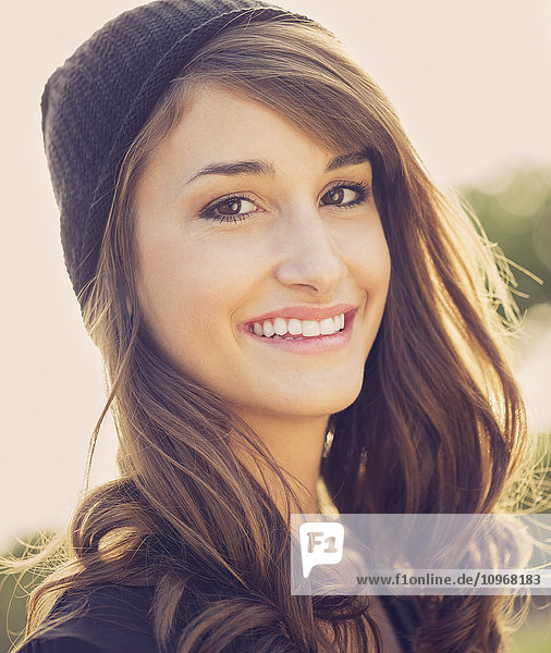 Fashion portrait of young beautiful woman outside  bright warm sunny color tones