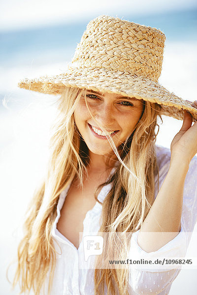 Fashion lifestyle  Portrait of beautiful happy blond girl on the beach