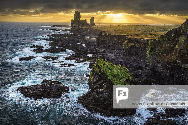 'The sea stack known as Londranger rises above the landscape  Snaefellsnes Peninsula; Iceland'