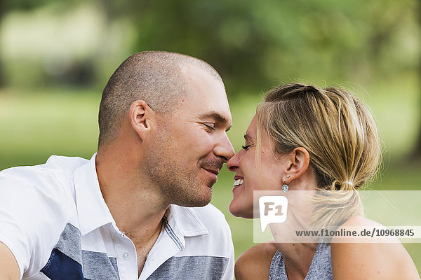 'A husband and wife kissing in a park; Edmonton  Alberta  Canada'