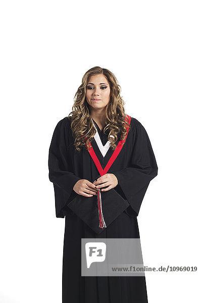 'Young graduating woman holding her graduation cap and contemplating her graduation; Edmonton  Alberta  Canada'