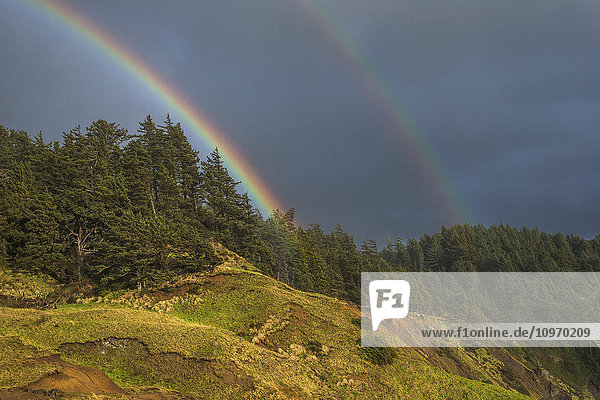 'Rainbows decorate the Oregon Coast; Cannon Beach  Oregon  United States of America'