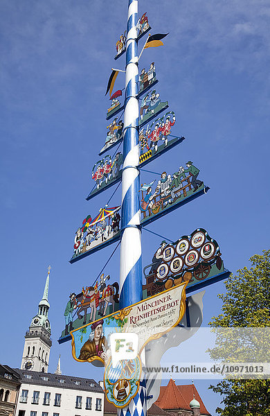 'A pole with colourful  decorative artwork in a town square; Munich  Bavaria  Germany'