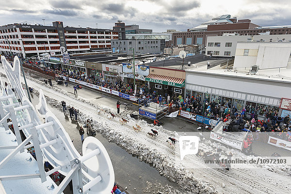 Scott Janssen leaves the start line on 4th avenue during the cermonial start day of Iditarod 2015 in Anchorage  Alaska