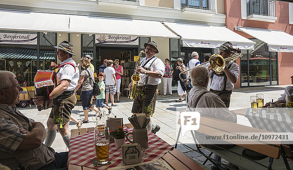 'Local band walking in the street; Berchtesgaden  Bavaria  Germany'