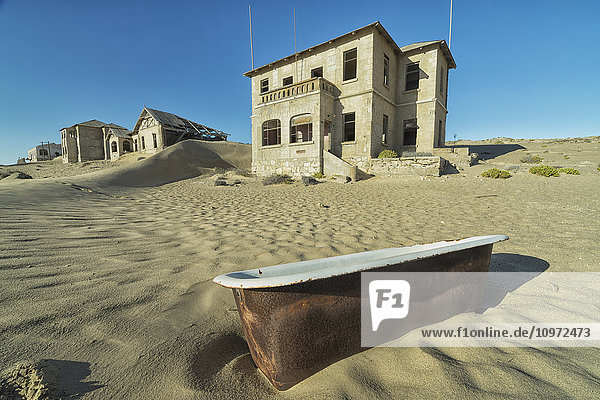 'Abandoned homes with an old bathtub lying in the sand; Kolmanskop  Namibia'