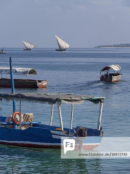 'Boats and dhows in the harbour; Zanzibar  Tanzania'