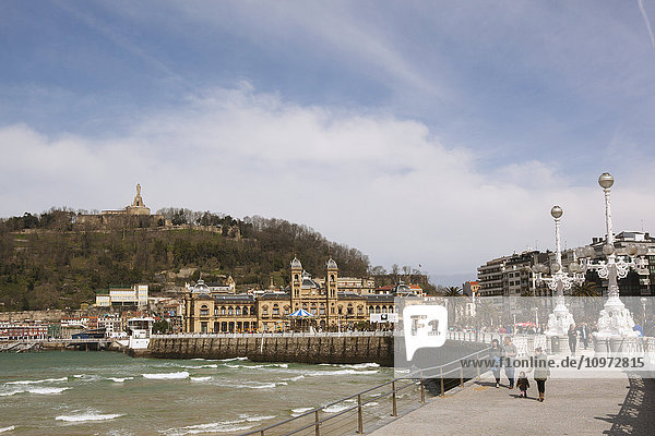 'High tide at La Concha bay  with the promenade leading towards the Old Town and fortress; San Sebastian  Spain'