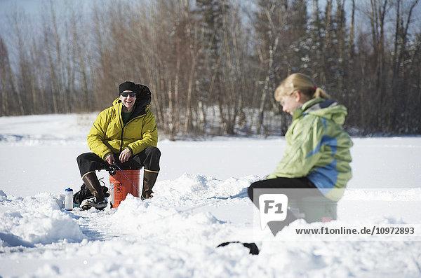 Ice fishing on Matanuska Lake in the Matanuska Valley north of Anchorage  Southcentral Alaska  winter
