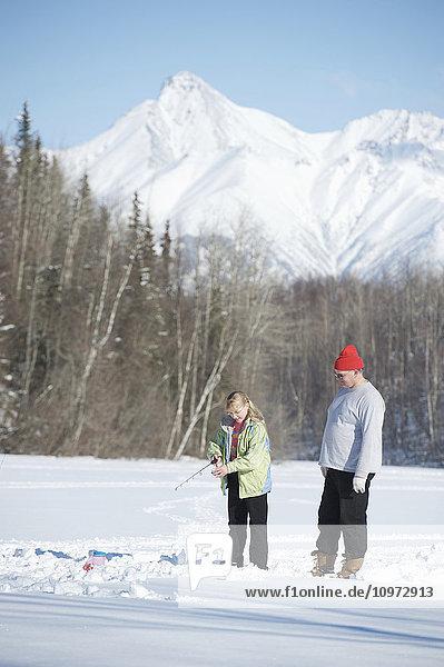 Ice fishing with guides on Matanuska Lake in the Matanuska Valley north of Anchorage  Alaska  winter