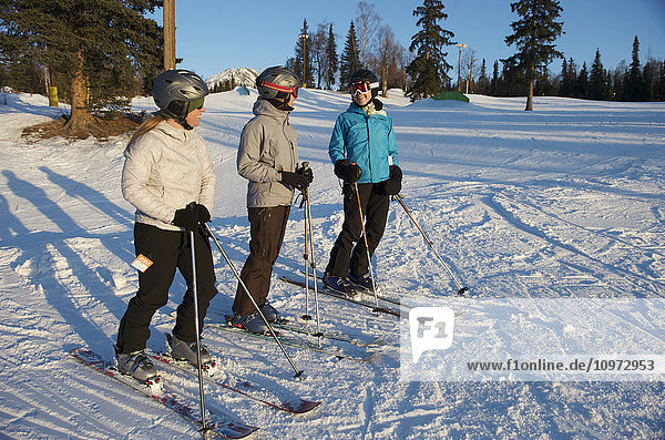 Friends skiing at Hilltop Ski Area in Anchorage  Alaska
