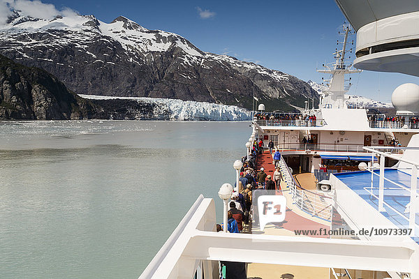 Visitors aboard a Pacific Princess Cruise ship view Margerie Glacier and Fairweather Mountains while in Tarr Inlet in Glacier Bay National Park in Southeast  Alaska