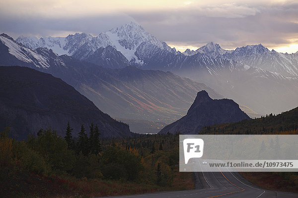 Scenic view of Lions Head mountain and the Chugach Mountains with Glenn Highway in the foreground  Autumn