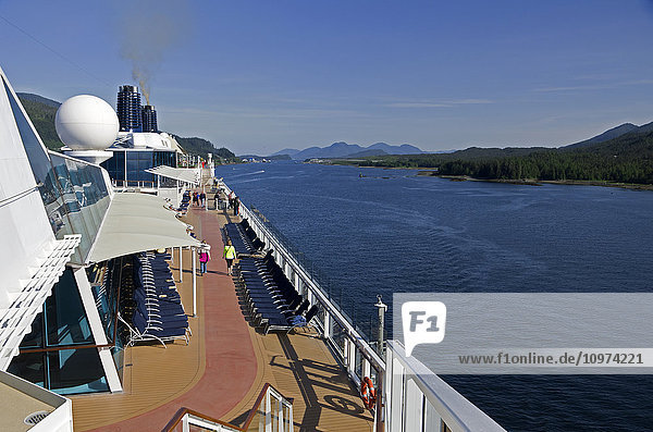 Top deck of Celebrity cruise ship as it cruises north on channel out of Ketchikan  Southeast Alaska  summer