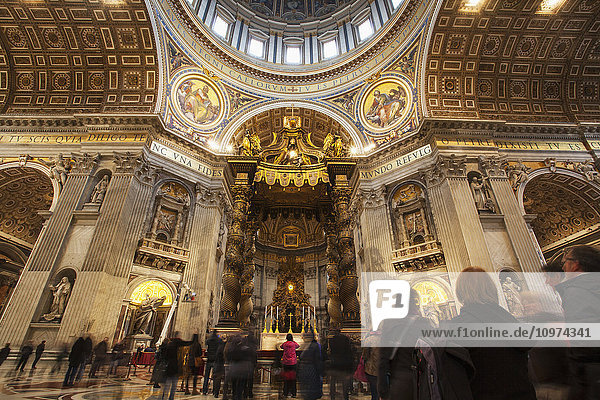 'Tourists and the Papal altar  St. Peter's Basilica; Rome  Italy'