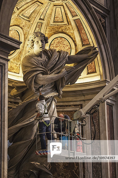 'Maintenance of the statue of St. Veronica  St. Peter's Basilica; Rome  Italy' 'Maintenance of the statue of St. Veronica, St. Peter's Basilica; Rome, Italy'