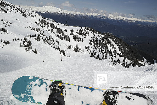 'Snowboard and boots with a view from a chairlift; Whistler  British Columbia  Canada'