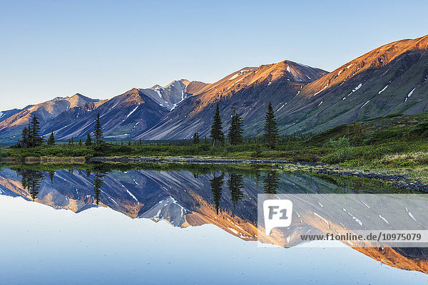 Morning light on Chigmit Mountains in Twin Lakes area of Lake Clark National Park & Preserve  Southcentral Alaska.