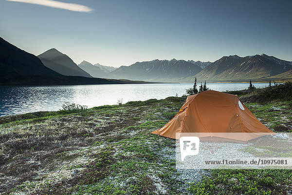 Scenic view of Lower Twin Lake with a backpacking tent in the foreground  Lake Clark National Park & Preserve  Southcentral Alaska