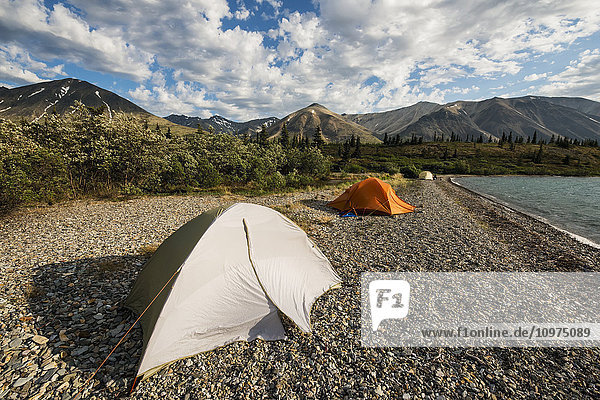 A group of tents sit on a beach in the Twin Lakes area of Lake Clark National Park & Preserve  Southcentral Alaska.
