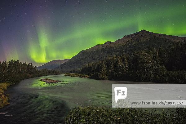 Aurora borealis over Portage Creek in Chugach National Forest  Alaska.