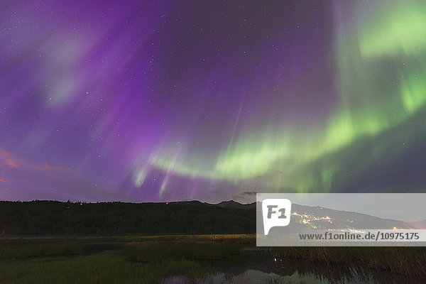 The aurora borealis over the Potter Valley neighborhood and Potter Marsh in south Anchorage  Alaska.