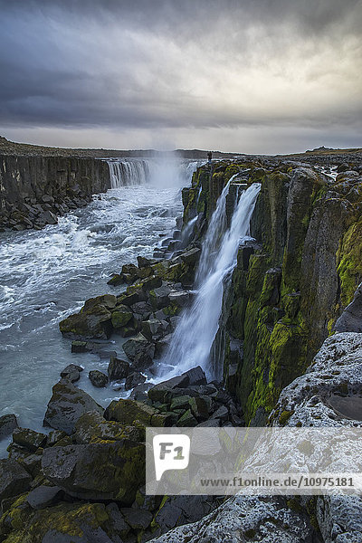 'Person photographing Selfoss in northern Iceland; Iceland'