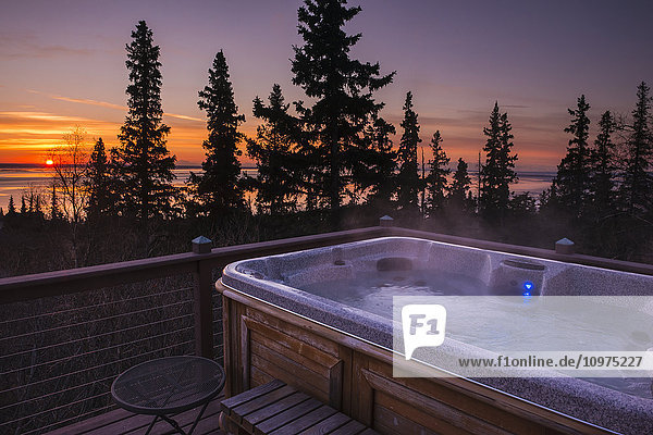 Sunset view from a deck and hot tub on the Anchorage hillside  South-central Alaska