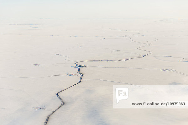 Aerial view of roads and other oil infrastructure on the Arctic tundra  Arctic Alaska  USA  Winter