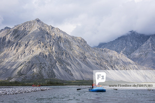 Rafters enjoy the day along the Marsh Fork of the Canning River in the Arctic National Wildlife Refuge  Summer  Alaska