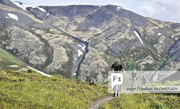 Mountain bikers on the Resurrection Pass Trail in the Chugach National Forest  Kenai Peninsula  Southcentral Alaska