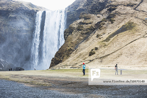 'Tourists visit the Seljalandsfoss waterfall; Iceland'