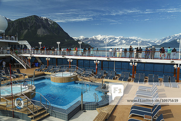 Tourists view Hubbard Glacier from the deck of Princess cruise ship  Southeast Alaska  summer