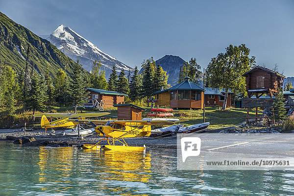 Two Super cub airplanes on Crescent Lake at Redoubt Mountain Lodge in Lake Clark National Park  Southcentral Alaska  summer
