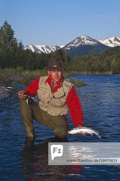 Flyfisherman Holding Rainbow Trout Kenai River Kenai Peninsula Alaska Summer Portrait
