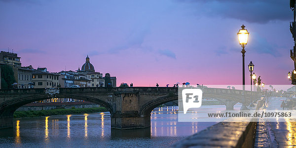'Bridges crossing the Arno River at dusk; Florence  Toscana  Italy'