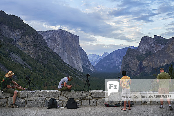 'Photographers waiting to shoot Tunnel View at sunset  Yosemite Valley  Yosemite National Park; California  United States of America'