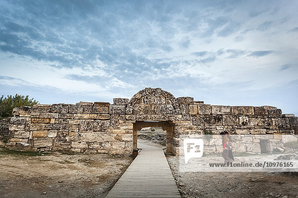 'Woman walking towards the South gate  Hierapolis; Pamukkale  Turkey' 'Woman walking towards the South gate, Hierapolis; Pamukkale, Turkey'