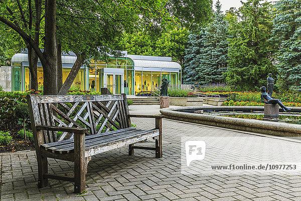'Bench in Leo Mol Sculpture Garden of Assiniboine Park; Winnipeg  Manitoba  Canada'