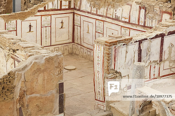 'Ancient stone walls and artwork in a museum; Ephesus  Izmir  Turkey' 'Ancient stone walls and artwork in a museum; Ephesus, Izmir, Turkey'
