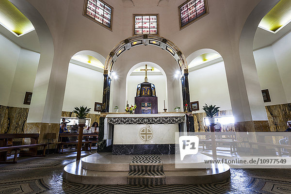 'Interior of a church with stained glass windows and altar; Galilee  Israel' 'Interior of a church with stained glass windows and altar; Galilee, Israel'