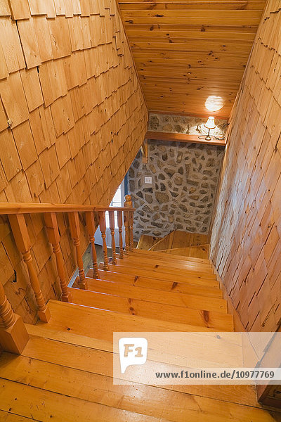 Pinewood Staircase Leading To The Downstairs Floor In A 1978 Reproduction Of An Old Canadiana Cottage Style Fieldstone Residential Home  Quebec  Canada. This Image Is Property Released. Pr0128