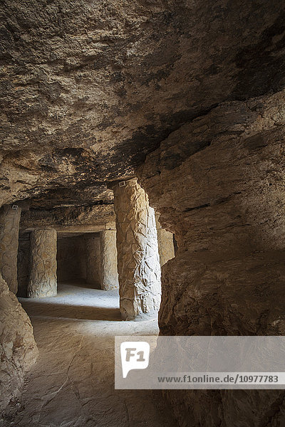 'Stone pillars in a cave with sunlight at the entrance; Bethlehem  Israel' 'Stone pillars in a cave with sunlight at the entrance; Bethlehem, Israel'