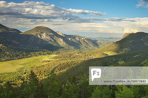 'Evening view down a valley from the lower part of the Trail Ridge Road in Rocky Mountain National Park; Colorado  United States of America'