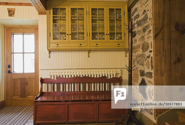 Storage Chest And Cupboard Cabinet In The Kitchen Of An Old Canadiana (Circa 1832) Cottage Style Residential Fieldstone Home  Quebec  Canada. This Image Is Property Released For Calendar  Book  Magazine And Editorial Use Only. Lupr0175
