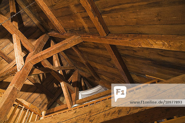 Exposed Wooden Beams  Rafters And Roof Boards In The Attic Of An Old Canadiana (Circa 1755) Cottage Style Residential Fieldstone Home  Quebec  Canada. This Image Is Property Released For Calendar  Book  Magazine And Editorial Use Only. Lupr0178