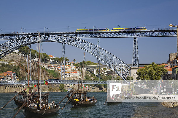 Dom Luis Bridge Over The Douro River With Moored Traditional Port Wine Boats  Porto  Portugal  Europe